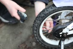 Children bicycle maintainance stock images