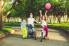 Children on bicycle in the park,  background toning for instagra Stock Images