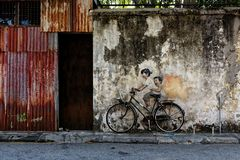 Children on a bicycle, public art in Penang, Malaysia. royalty free stock photo