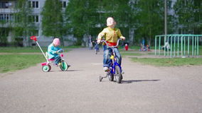 Children with bicycles stock video