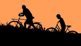 Two boys go with bikes in the evening. Two boys go with bikes through the grass. Dark silhouettes against the orange sky vector illustration