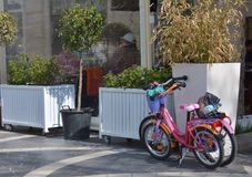 Children bicycles waiting on parking Royalty Free Stock Photo