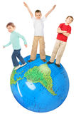 Children on big inflatable globe collage Stock Image