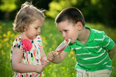 Children and a big lollipop Stock Images