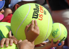Children with big tennis balls stock images