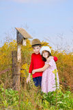 Children and a Bird house. Boy and girl standing by a bird house stock images