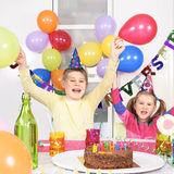Children at birthday. Party in house Stock Photography