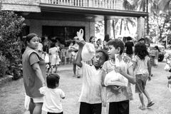 Children black and white with food aid earthquake Stock Photos