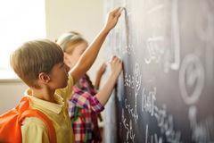 Children by blackboard Stock Photography