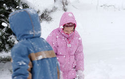 Children in blizzard. Two children in snowfall in cold winter Stock Images