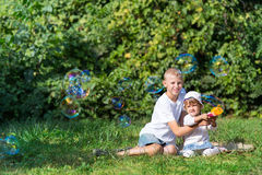 Children blow bubbles Stock Image