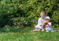 Children blow bubbles Royalty Free Stock Photos