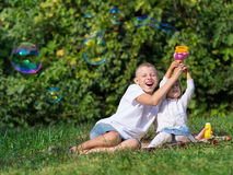 Children blow bubbles Royalty Free Stock Photo