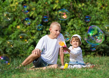 Children blow bubbles. In the park stock photography