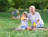 Children blow bubbles Royalty Free Stock Image