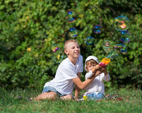Children blow bubbles. In the park Royalty Free Stock Images