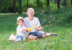 Children blow bubbles. In the park Royalty Free Stock Image