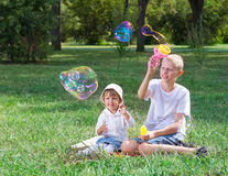 Children blow bubbles. In the park Stock Image