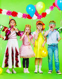 Children with blow outs. Children group with birthday blow outs Stock Photo