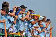 The children blow the vuvuzela Royalty Free Stock Image