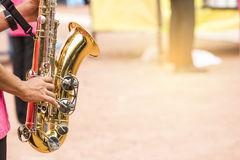 Children are blowing baritone Saxophone jazz music Stock Photos