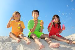 Children blowing bubbles Stock Images