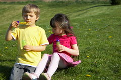 Children blowing bubbles Royalty Free Stock Images