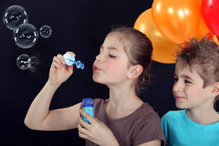 Children blowing bubbles Stock Image