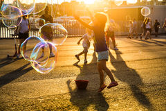 Children blowing bubbles and playing royalty free stock photography