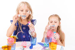 Children blowing soap bubbles Royalty Free Stock Photos