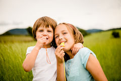 Children blowing whistle Royalty Free Stock Photo