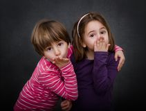 Children blows kiss. Children expression and emotion in gray background Stock Photos