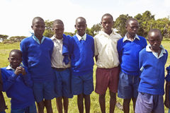 Children in blue lineup at school near Tsavo National Park, Kenya, Africa Royalty Free Stock Photography