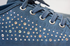 Children blue sneakers with glitter Stock Photo