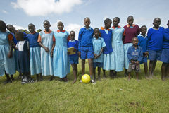 Children in blue uniforms holding soccer ball at school near Tsavo National Park, Kenya, Africa Royalty Free Stock Photos