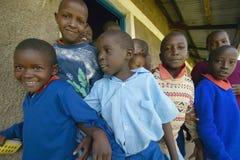 Children in blue uniforms at school near Tsavo National Park, Kenya, Africa Stock Photo
