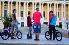 Children on BMX bikes and skates Stock Image