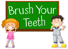 Children and board saying brush your teeth Royalty Free Stock Image