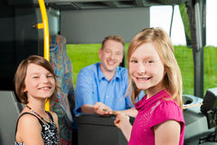 Children boarding a bus Stock Photos