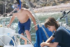 Children on boat. Young girl and boy on vacation on a boat at Catalina Island, California royalty free stock images