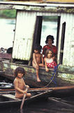 Children in boat house, Amazonia. stock images