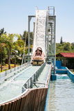 Children in boat on water slide attraction Royalty Free Stock Photography
