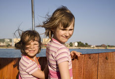 Children on the boat in the wind Royalty Free Stock Photos