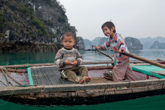 Children boating in Halong Royalty Free Stock Photos