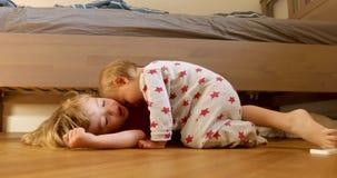 Children bonding on floor. Blonde children bonding on wooden floor near bed stock footage