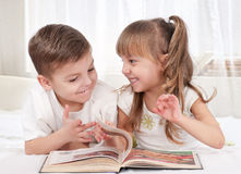 Children with book Royalty Free Stock Images