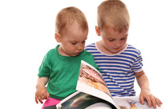 Children and book. Children watch book Stock Photos