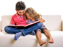 Children with book at home Royalty Free Stock Images