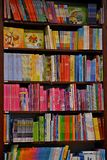 Children bookcase. Dark brown wooden modern bookcase fully filled with kids´books Royalty Free Stock Photography