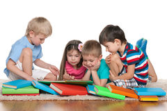 Children with books. Group of children with books on the floor Stock Photography